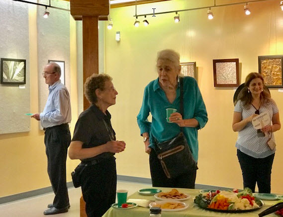 Nina Tisara talks with fellow artist Marian Van Landingham at the opening reception at Huntley Meadows Visitors Center - Photo credit Jordan Wright