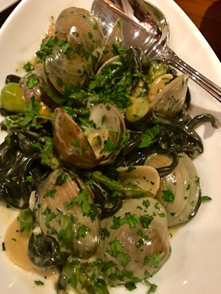 Steamed cockles on squid ink pasta at Tredici Enoteca