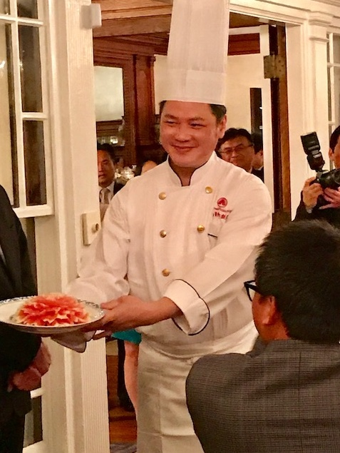 Chef Liu shows his carved vegetable flower to great applause