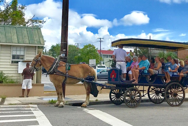Horse-drawn wagons take sightseers around the old city