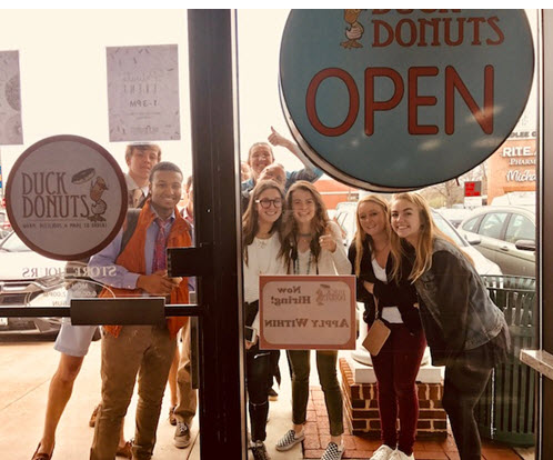 Teens await opening of Duck Donuts