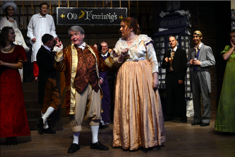 Larry Grey as Fezziwig and Hannah Pecoraro as Mrs. Fezziwig and cast ~ Photo credit Michael DeBlois