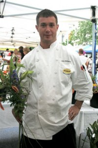 Photo by Jordan Wright - Chef Brian McPherson of Poste Moderne with lilies