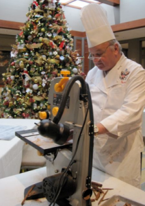 Chef Mesnier cuts the gingerbread with a band saw - photo credit Jordan Wright