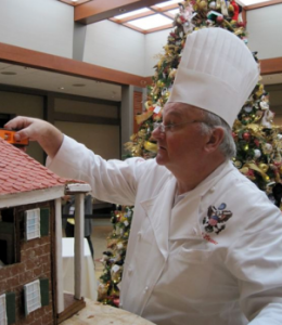 Chef Mesnier checks the angles of his gingerbread house at Mount Vernon - photo credit Jordan Wright